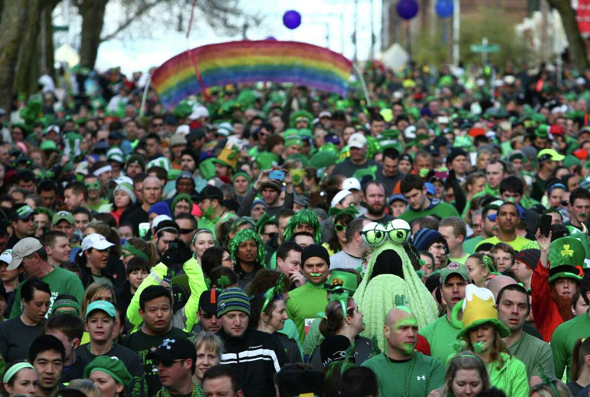 Participants gather at the start line of the St. Patrick's Day Dash in downtown Seattle. Thousands of green-clad people participated in the annual race and beer fest at Seattle Center.