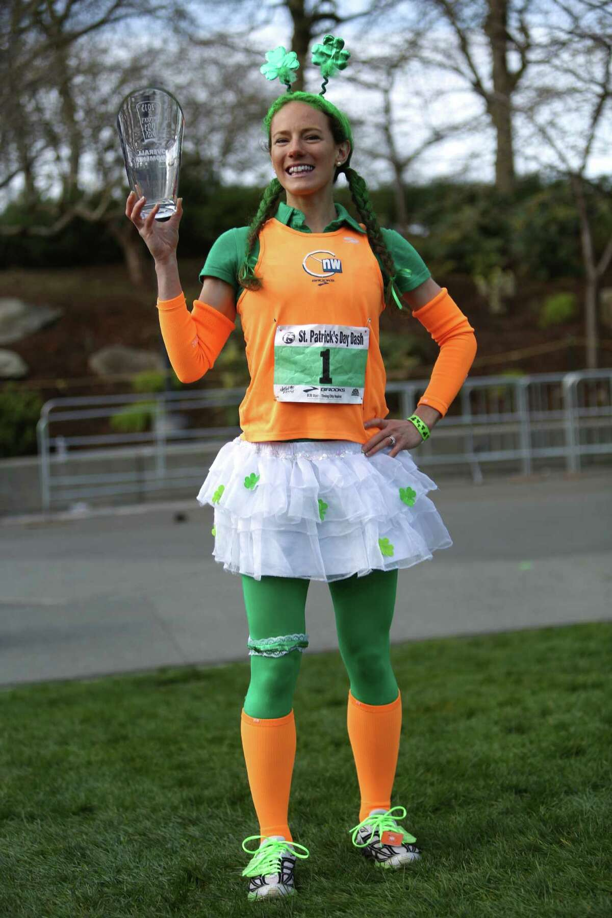 Rose Wetzel holds her first place trophy after completing the St. Patrick's Day Dash in downtown Seattle. This is Wetzel's fourth time winning the annual race. Thousands of green-clad people participated in the annual race and beer fest at Seattle Center.