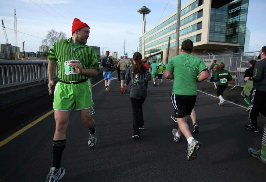Kevin Koski of Bremerton runs the entire race backwards during the St. Patrick's Day Dash in downtow