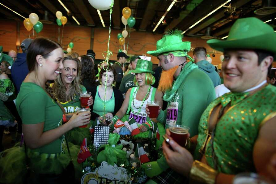 People gather in the beer garden in Fisher Pavilion during the St. Patrick's Day Dash in downtown Se