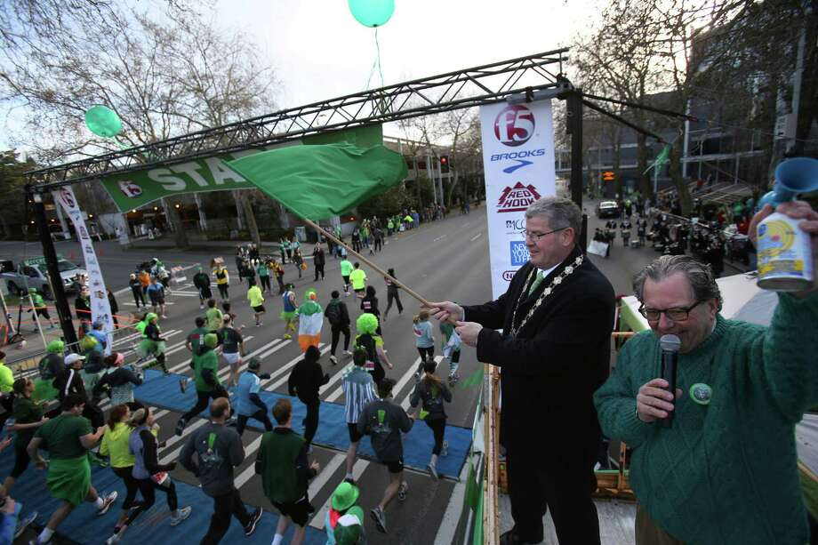 Frank Fahy, deputy Mayor of Galway, Ireland, and Mick McHugh, owner of F.X. McRory's Steak Chop and Oyster House, signal the start of the St. Patrick's Day Dash in downtown Seattle. Thousands of green-clad people participated in the annual race and  beer fest at Seattle Center. Photo: JOSHUA TRUJILLO, SEATTLEPI.COM / SEATTLEPI.COM