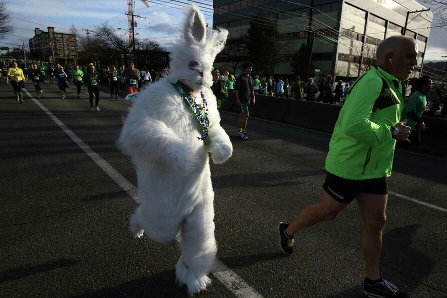 Runners make their way along the course during the St. Patrick's Day Dash in downtown Seattle. Thous