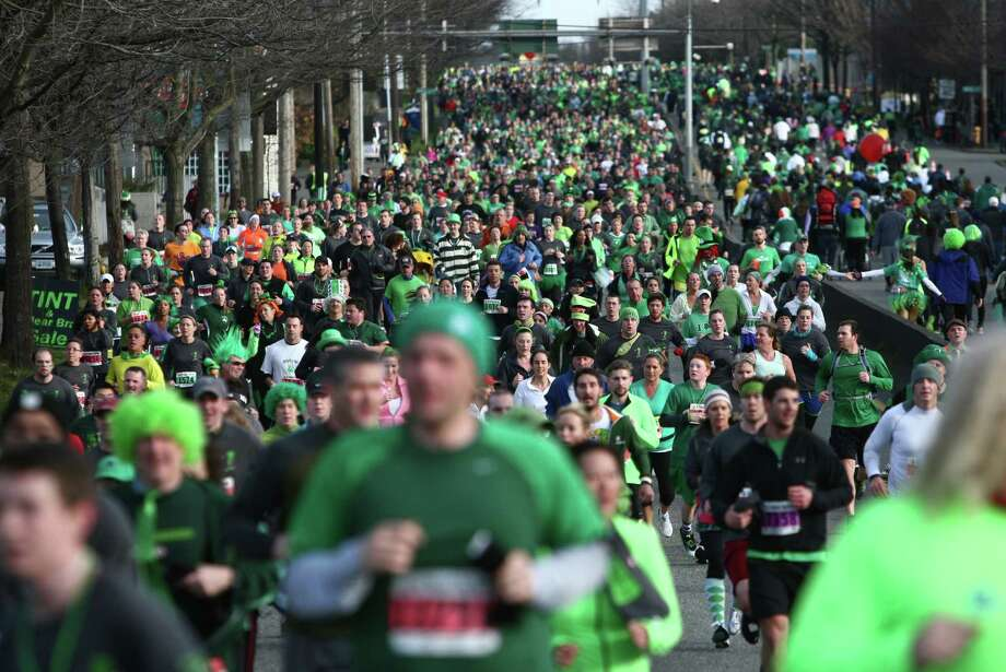 Runners make their way along the course during the St. Patrick's Day Dash in downtown Seattle. Thousands of green-clad people participated in the annual race and  beer fest at Seattle Center. Photo: JOSHUA TRUJILLO, SEATTLEPI.COM / SEATTLEPI.COM