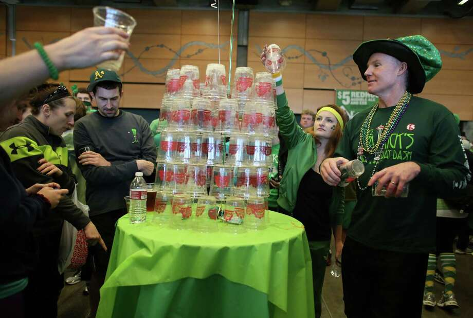 Participants stack their beer cups in the beer garden during the St. Patrick's Day Dash in downtown Seattle. Thousands of green-clad people participated in the annual race and  beer fest at Seattle Center. Photo: JOSHUA TRUJILLO, SEATTLEPI.COM / SEATTLEPI.COM