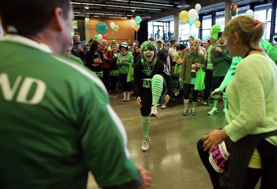 Participants dance to Irish music during the St. Patrick's Day Dash in downtown Seattle. Thousands of green-clad people participated in the annual race and  beer fest at Seattle Center. Photo: JOSHUA TRUJILLO, SEATTLEPI.COM / SEATTLEPI.COM