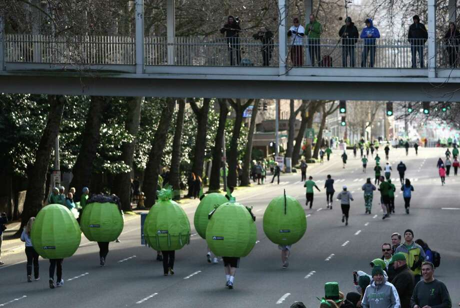 """Green eggs and Spam"" make their way from the start line of the St. Patrick's Day Dash in downtown Seattle. Thousands of green-clad people participated in the annual race and  beer fest at Seattle Center. Photo: JOSHUA TRUJILLO, SEATTLEPI.COM / SEATTLEPI.COM"