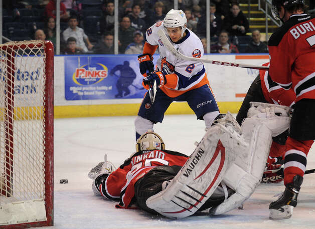 Albany goalie Keith Kincaid sprawls for the puck in front of Sound Tiger Nino Niederreiter during the second period of their AHL hockey matchup at Webster Bank Arena in Bridgeport, Conn. on Sunday, March 17, 2013. Photo: Brian A. Pounds / Connecticut Post