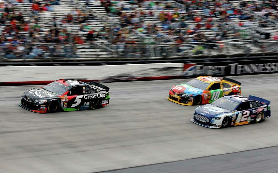 Kasey Kahne (5) races ahead of Brad Keselowski (2) and Kyle Busch at Bristol Motor Speedway. It appeared there was going to be a close finish, but Kahne ended up cruising to the victory. Photo: Jared Wickerham / Getty Images
