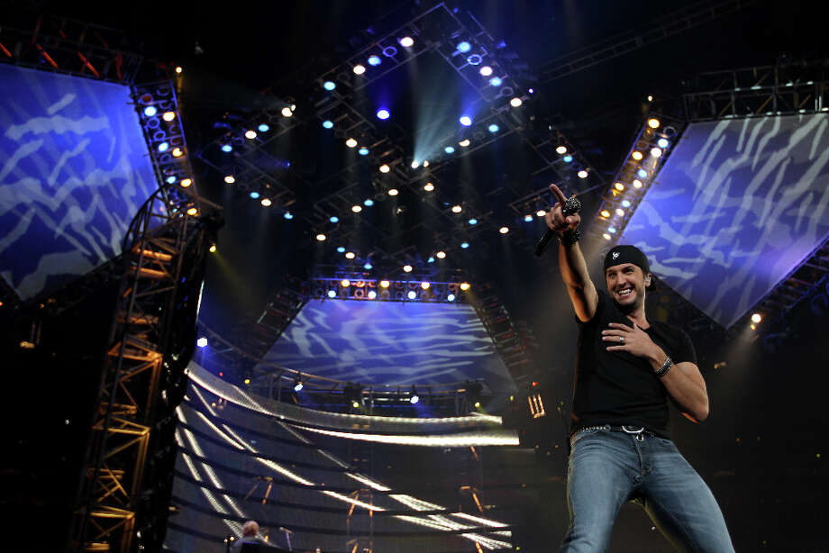 "LUKE BRYAN: Give Bryan credit for knowing his audience. Less than halfway into his first song, ""Kiss Tomorrow Goodbye, Bryan stopped in his tracks and swiveled his hips. A fierce chorus of screams ensued. A few seconds later, he turned around and shook his behind for the camera. Cue louder squeals. Photo: Karen Warren / © 2013 Houston Chronicle"