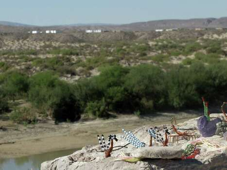 In this Oct. 31, 2011 photo, handicrafts made in Boquillas del Carmen, Mexico across the Rio Grande await tourists at an overlook in Big Bend National Park, Texas. In this rugged, remote West Texas terrain where wading across the shallow Rio Grande undetected is all too easy, federal authorities are touting a proposal to open an unmanned port of entry as a security upgrade. If approved, the crossing would be the nation's first such port of entry with Mexico. Photo: Christopher Sherman, Associated Press / AP