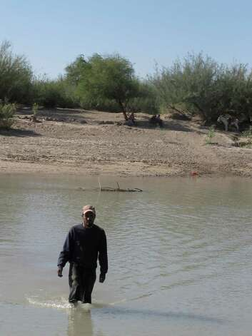 In this Oct. 31, 2011 photo, Guillermo Gonzalez Diaz, resident of Boquillas del Carmen, Mexico, wades into the Rio Grande across from Big Bend National Park, Texas. In this rugged, remote West Texas terrain where wading across the shallow Rio Grande undetected is all too easy, federal authorities are touting a proposal to open an unmanned port of entry as a security upgrade. If approved, the crossing would be the nation's first such port of entry with Mexico. Photo: Christopher Sherman, Associated Press / AP