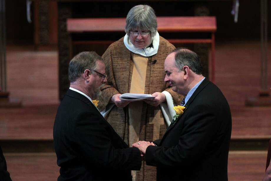 Jeff Meadows and Gary Patterson recite The Commitment during The Witness and Blessing of a Lifelong Covenant at St. Stephen's Episcopal Church on Sunday. Photo: Mayra Beltran, Staff / © 2013 Houston Chronicle