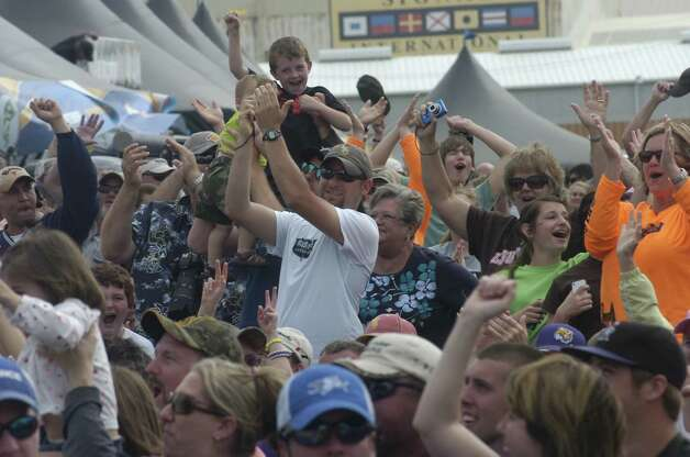 Spectators cheer during the final weigh-in of the Bassmaster Elite Series Sabine River Challenge in Orange on Sunday, March 17, 2013. Photo: Jared Ainsworth