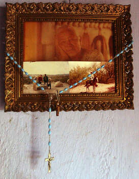 Pictures and rosaries hang on the walls of Pablo Robles house in Boquillas del Carmen, Mexico on Wednesday, July 21, 2004. Photo: JERRY LARA, San Antonio Express-News / SAN ANTONIO EXPRESS-NEWS
