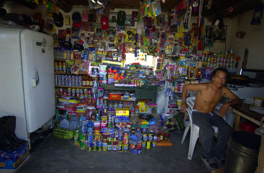 Juan Pandilla runs a convenience store from his two room home in Boquillas del Carmen, Mexico, in September 2001. After the Sept. 11 attacks, the U.S.-Mexico border crossing at Big Bend National Park was closed, cutting Boquillas residents off from tourist dollars. Photo: GLORIA FERNIZ, San Antonio Express-News / SAN ANTONIO EXPRESS-NEWS