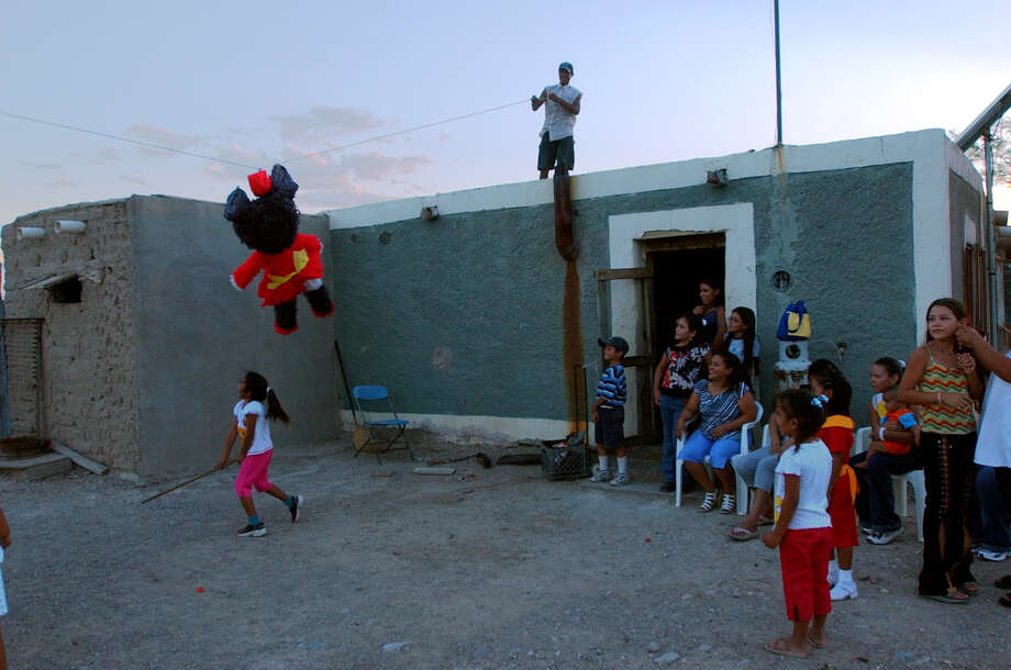 Children take their shot at a pinata during a birthday party in Boquillas del Carmen, Mexico on Tuesday, July 20, 2004. Photo: JERRY LARA, San Antonio Express-News / SAN ANTONIO EXPRESS-NEWS