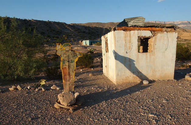A metal soldier warns travels to stop at the entrance to Boquillas del Carmen, Mexico on Tuesday, July 20, 2004. The site used to be the barracks for Mexican soldiers stationed in the area. Photo: JERRY LARA, San Antonio Express-News / SAN ANTONIO EXPRESS-NEWS