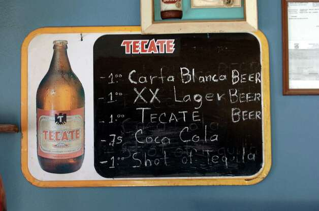 Prices are still in U.S. dollars at the Park Bar in Boquillas del Carmen, Mexico, on Wednesday, July 21, 2004. The bar was a popular spot for U.S. tourists, but the flow has dried up since the U.S. government shut down the border crossing between the town and Big Bend National Park in May 2002. Photo: JERRY LARA, San Antonio Express-News / SAN ANTONIO EXPRESS-NEWS