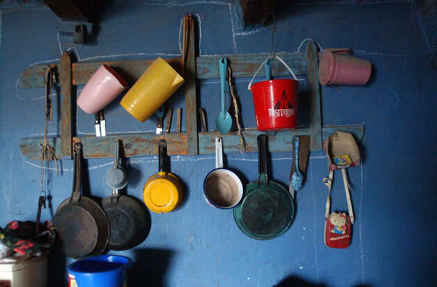 Kitchen utensils hang from the wall at the Pablo Robles residence in Boquillas del Carmen, Mexico on Wednesday, July 21, 2004. Robles has Pablo's Rock Shop and would sell his merchandise to American tourists from Big Bend National Park. Photo: JERRY LARA, San Antonio Express-News / SAN ANTONIO EXPRESS-NEWS