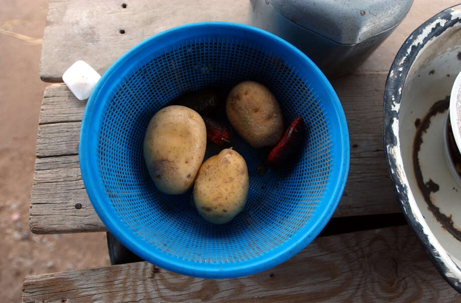 Potatoes and chilies are the meal in the Pablo Robles residence in Boquillas del Carmen, Mexico on Wednesday, July 21, 2004. Photo: JERRY LARA, San Antonio Express-News / SAN ANTONIO EXPRESS-NEWS