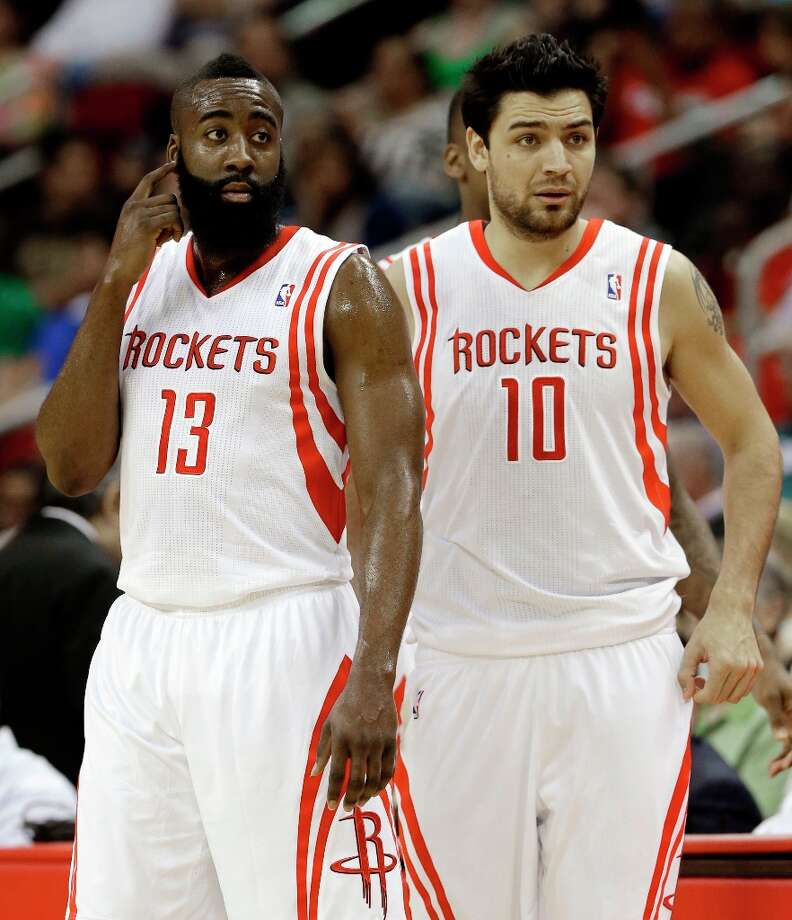 James Harden and Carlos Delfino head back onto the court after a timeout in the first half. Photo: Pat Sullivan
