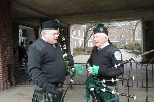 Dr.Robert Liftig, of Westport, speaks with Don Cavett, of Darien, at the GreenwichâÄôs 39th annual St. PatrickâÄôs Day parade at Greenwich Avenue, in Greenwich, Conn., March 17, 2013. Photo: Helen Neafsey / Greenwich Time