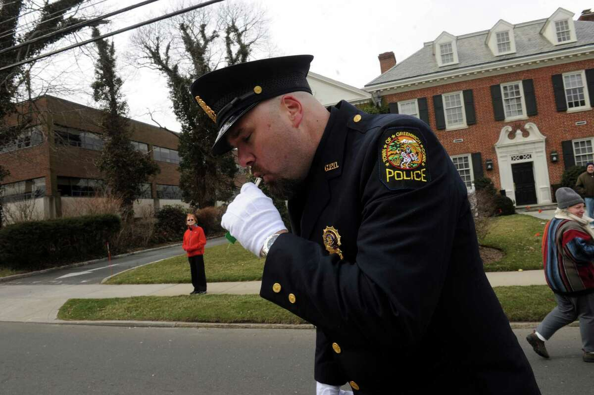Greenwich Police Stan Sanders, starts the Greenwich 39th annual St. PatrickâÄôs Day parade at Greenwich Avenue, in Greenwich, Conn., March 17, 2013.