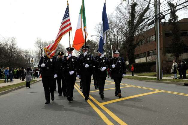 Greenwich Police Color Guard march at the GreenwichâÄôs 39th annual St. PatrickâÄôs Day parade at Greenwich Avenue, in Greenwich, Conn., March 17, 2013. Photo: Helen Neafsey / Greenwich Time