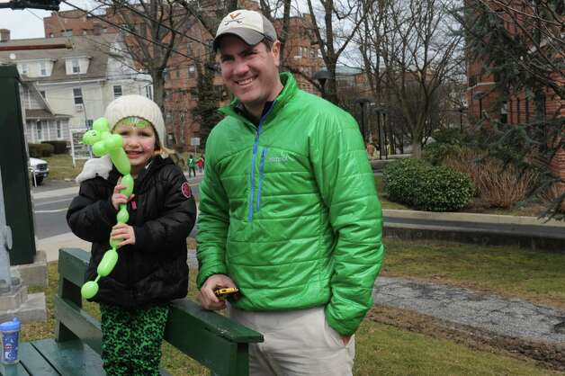 Lily Cassin, 3, and her father Brian, of Greenwich, wait for the Greenwich's 39th annual St. Patrick's Day parade at Greenwich Avenue, in Greenwich, Conn., March 17, 2013. Photo: Helen Neafsey / Greenwich Time