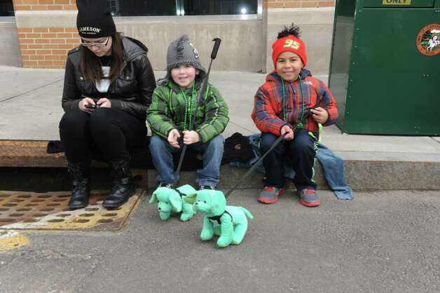 Valeska Diaz, 22, with Lucas Baily, 6 and Gavin Sieling, 5, wait for the Greenwich's 39th annual St. Patrick's Day parade at Greenwich Avenue, in Greenwich, Conn., March 17, 2013. Photo: Helen Neafsey / Greenwich Time