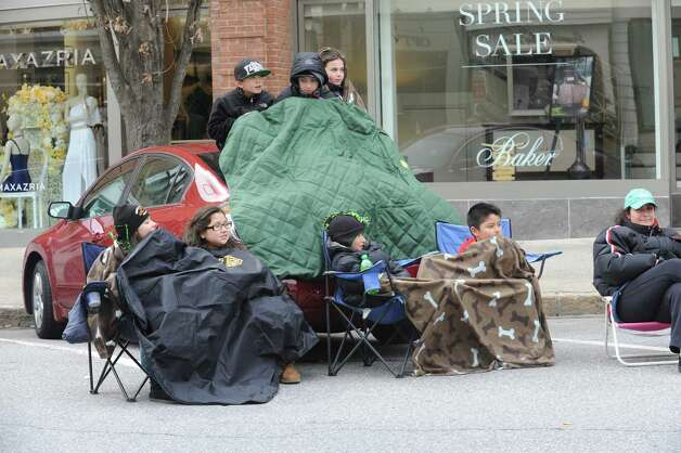 Children keep warm during the GreenwichâÄôs 39th annual St. PatrickâÄôs Day parade at Greenwich Avenue, in Greenwich, Conn., March 17, 2013. Photo: Helen Neafsey / Greenwich Time