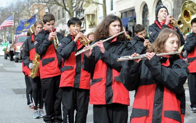 Greenwich High School band march at the GreenwichâÄôs 39th annual St. PatrickâÄôs Day parade at Greenwich Avenue, in Greenwich, Conn., March 17, 2013. Photo: Helen Neafsey / Greenwich Time