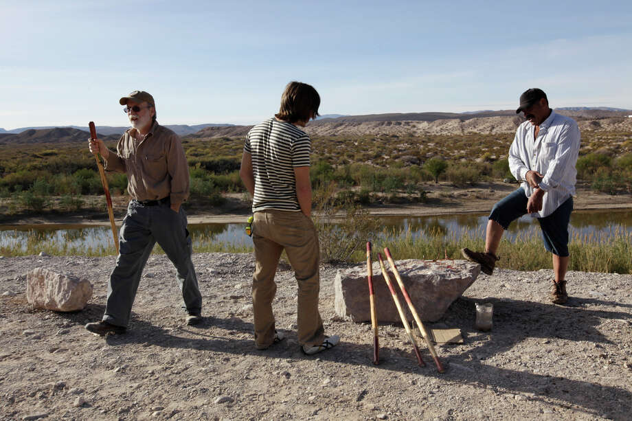 Landy Johnston and his stepson Ethan Jones of Hunstville, Texas buy a cane from Sylvestre Sanchez, right, a Boquillas del Carmen, Mexico resident, at an overlook in Big Bend National Park, Thursday, Jan. 6, 2011. Customs and Border Protection Commissioner Alan Bersin announced the reopening of the international crossing at Boquillas inside the park. The crossing was closed in May 2002 in reaction to the Sept. 11 attacks. Rio Grande Village is the closest store to the crossing and was used by many of citizens of Boquillas as their grocery store before the closing of the border. The crossing was also popular with park tourists that would cross into Mexico for beer, food and crafts. Photo: JERRY LARA, San Antonio Express-News / glara@express-news.net