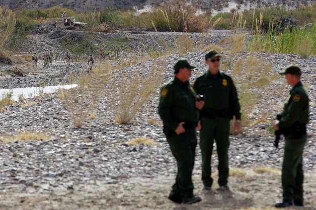 Mexican Army personnel, left, patrol the Rio Grande by Boquillas del Carmen, Mexico, as Border Patrol agents stand guard while Customs and Border Protection Commissioner Alan Bersin visits the former international crossing at Boquillas in Big Bend National Park, Thursday, Jan. 6, 2011. The crossing was closed in May 2002 in reaction to the Sept. 11 attacks. Photo: JERRY LARA, San Antonio Express-News / glara@express-news.net