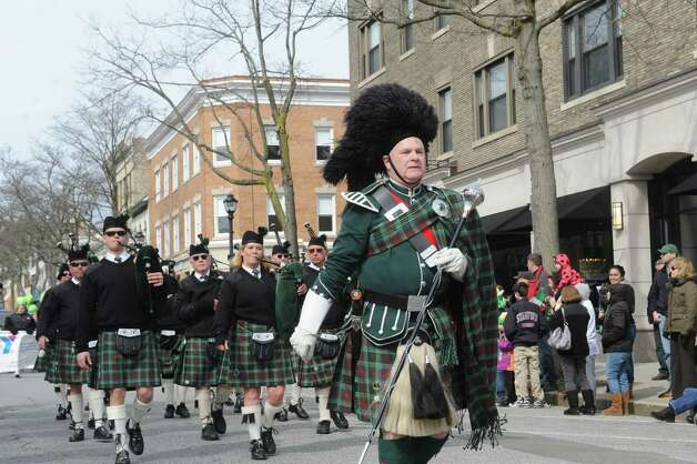 Pat McGarnon directs the Fairfield Gaelic Pipes & Drums at the Greenwich's 39th annual St. Patrick's Day parade at Greenwich Avenue, in Greenwich, Conn., March 17, 2013. Photo: Helen Neafsey / Greenwich Time
