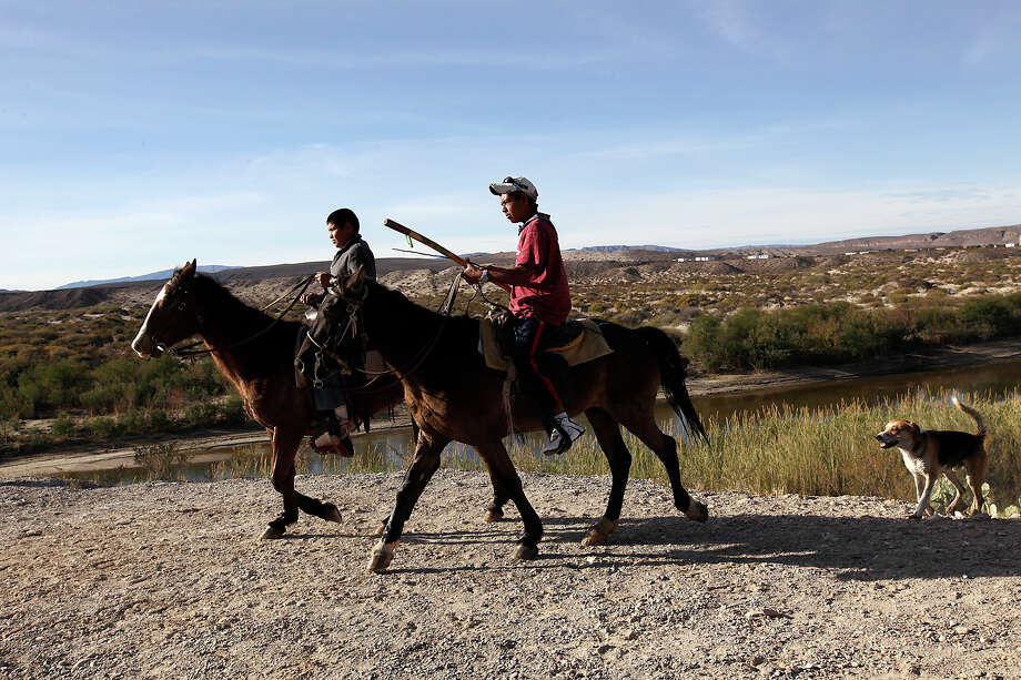 Children on horseback cross into Big Bend National Park from Boquillas del Carmen, Mexico, Thursday, Jan. 6, 2011. Customs and Border Protection Commissioner Alan Bersin announced the reopening of the international crossing at Boquillas in the park, during a press conference later in the day. The crossing was closed in May 2002 in reaction to the Sept. 11 attacks. Photo: JERRY LARA, San Antonio Express-News / glara@express-news.net