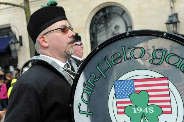 Fairfield Gaelic Pipes & Drums march at the GreenwichâÄôs 39th annual St. PatrickâÄôs Day parade at Greenwich Avenue, in Greenwich, Conn., March 17, 2013. Photo: Helen Neafsey / Greenwich Time