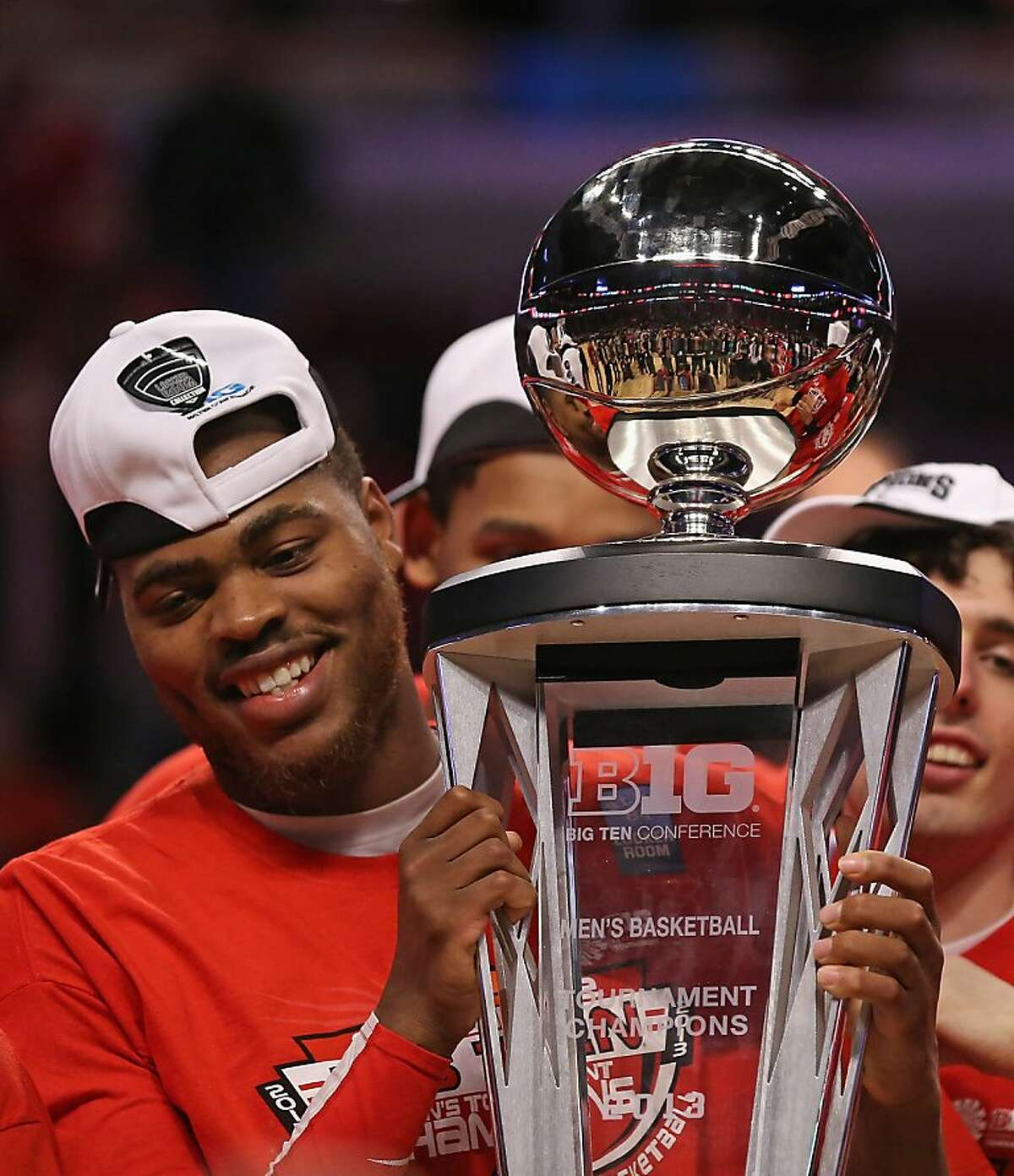 DeShaun Thomas #1 of the Ohio State Buckeyes holds the trophy after the Buckeyes defeated the Wisconsin Badgers during the Big Ten Basketball Tournament Championship game at United Center on March 17, 2013 in Chicago, Illinois. Ohio State defeats Wisconsin 50-43.