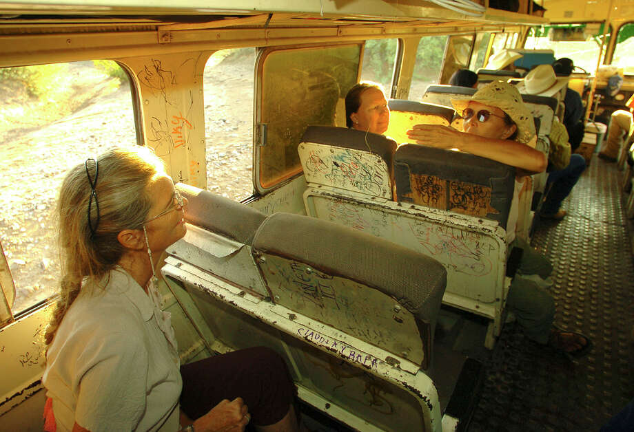 Cynta de Narvaez, left, Wendy Weckessen and Zoey Sexton converse on the bus carrying them and their merchandise out of Boquillas del Carmen to Musquiz, Mexico, in October 2006. From there, they will take their shipment to Del Rio, Texas, and north to the Big Bend. The three are residents of the Big Bend area and have started their import program to help Boquillas residents create a livelihood. Photo: BILLY CALZADA, San Antonio Express-News / SAN ANTONIO EXPRESS-NEWS