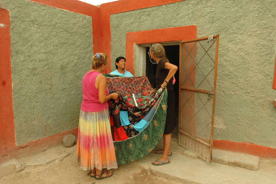 Juanita Luna, middle, displays her quilting handiwork to Zoey Sexton, left, and Cynta de Narvaez in October 2006. The residents of Boquillas del Carmen, Mexico, have been searching for new livelihood since the tourists from Big Bend stopped arriving in 2002. The quilt will be sold in Big Bend. Photo: BILLY CALZADA, San Antonio Express-News / SAN ANTONIO EXPRESS-NEWS
