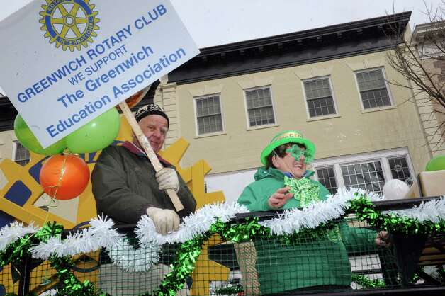 Greenwich Rotary Club march in the GreenwichâÄôs 39th annual St. PatrickâÄôs Day parade at Greenwich Avenue, in Greenwich, Conn., March 17, 2013. Photo: Helen Neafsey / Greenwich Time