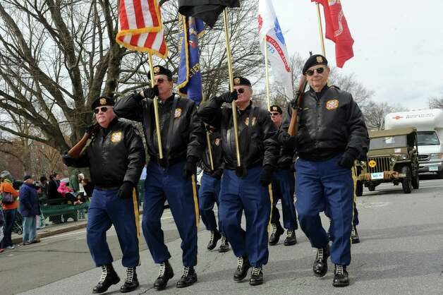 The VFW Post 9460 Color Guard march in the GreenwichâÄôs 39th annual St. PatrickâÄôs Day parade at Greenwich Avenue, in Greenwich, Conn., March 17, 2013. Photo: Helen Neafsey / Greenwich Time