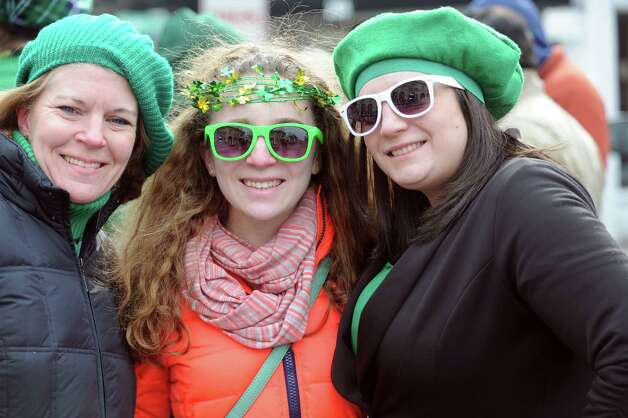 Mary Beth Montague, her daughters Maggie, 14, and Kellie, 26, watching the GreenwichâÄôs 39th annual St. PatrickâÄôs Day parade at Greenwich Avenue, in Greenwich, Conn., March 17, 2013. Photo: Helen Neafsey / Greenwich Time