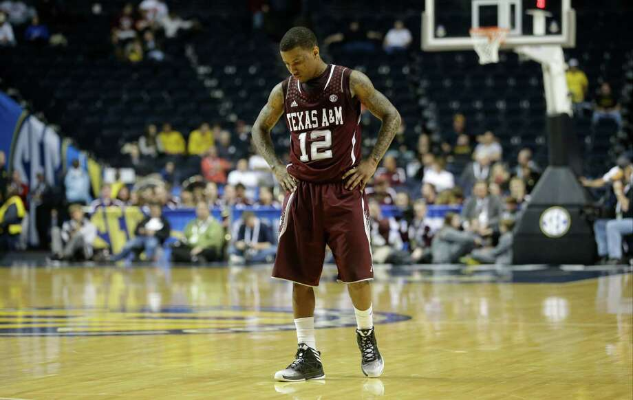 Texas A&M guard Fabyon Harris (12) walks on the court in the closing moments during the second half of an NCAA college basketball game against the Missouri at the Southeastern Conference tournament, Friday, March 15, 2013, in Nashville, Tenn. Missouri won 62-50. (AP Photo/John Bazemore) Photo: John Bazemore, Associated Press / AP