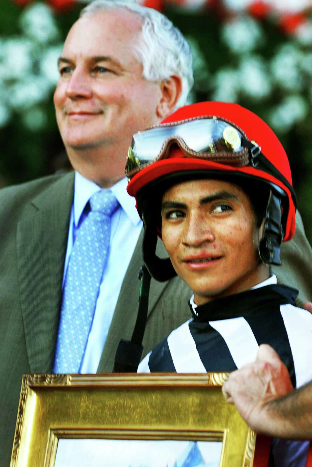 Times Union staff photo by John Carl D'Annibale: NYRA's Charlie Hayward, left, and Jockey Alan Garcia during photo op in the winners circle after Garcia's winning of The Hopeful at Saratoga Race Course Monday afternoon September 1, 2008. SARATOGA RACE TRACK