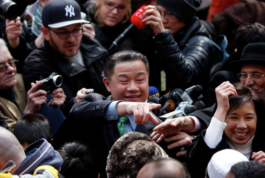 New York City Comptroller John Liu greets supporters after announcing the launch of his mayoral campaign on the steps of City Hall, Sunday, March 17, 2013 in New York.  Already the first person of Asian descent to be elected citywide in New York, Liu hopes to become the city's first Asian-American mayor. (AP Photo/Jason DeCrow) Photo: Jason DeCrow