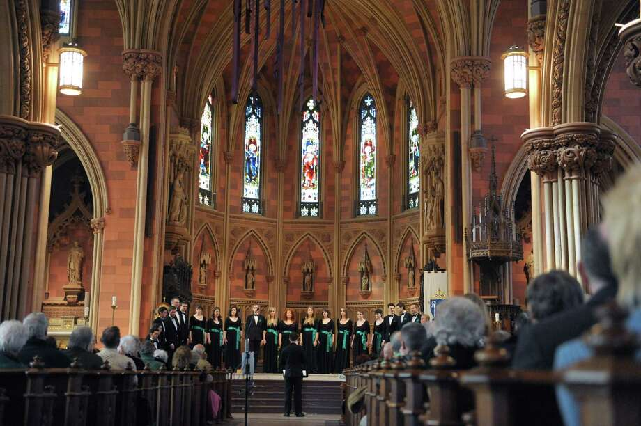 Conductor, Michael Dawson, leads the members of the National University of Ireland Maynooth Chamber Choir perform at the Cathedral of the Immaculate Conception on Sunday, March 17, 2013 in Albany, NY.   The choir group is on its first ever North American tour.  (Paul Buckowski / Times Union) Photo: Paul Buckowski