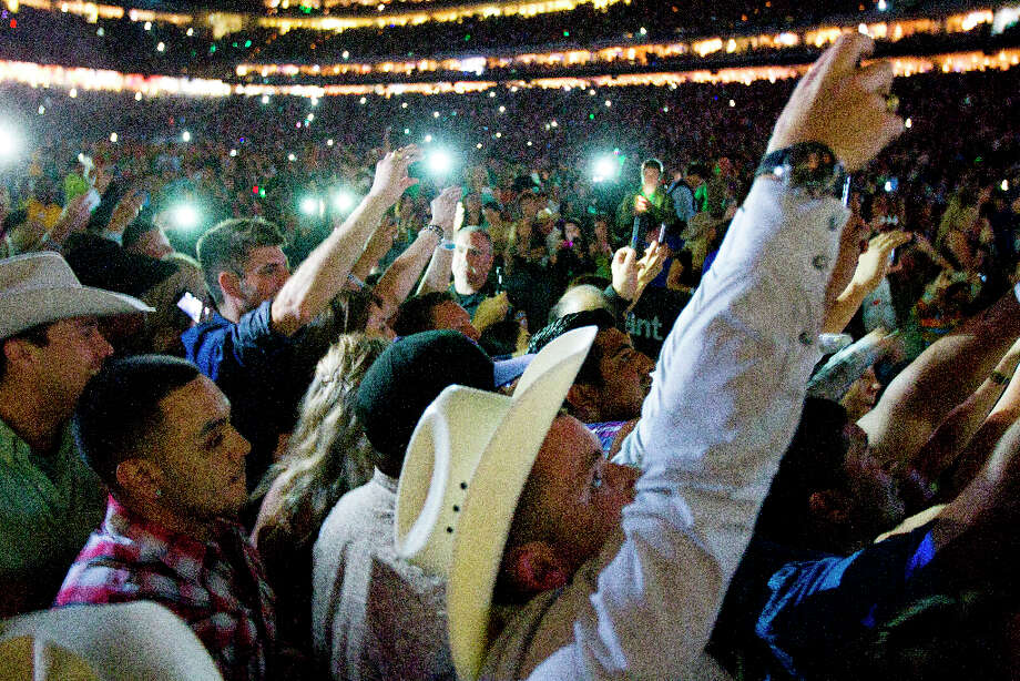 Fans reach out to George Strait. Photo: Brett Coomer / © 2013 Houston Chronicle