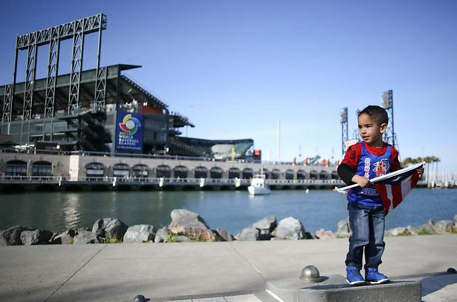 Marcelo Mendez plays outside AT&T ballpark before the start of the World Baseball Classic semi-final game between Puerto Rico and Japan in San Francisco on Sunday, March 17, 2013. Photo: Mathew Sumner, Special To The Chronicle