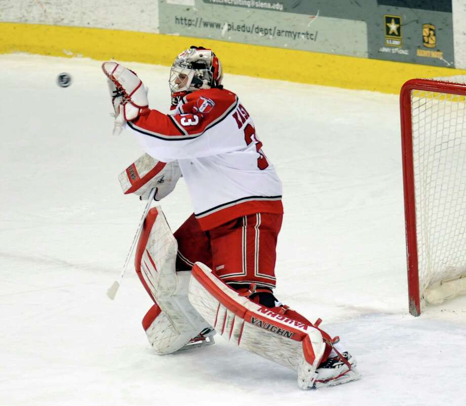 Rensselaer Polytechnic Institute Goalie Jason Kasdorf gloves a shot by Brown University during the first period of a ECAC college hockey game in Troy N.Y., Sunday, March 17, 2012. (Hans Pennink / Special to the Times Union) College Sports. Photo: Hans Pennink / Hans Pennink